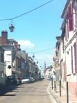 Lanterns on chains in small village near Paris